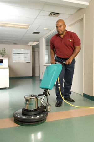 Man buffing Tile floor