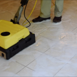 man cleaning tile floor