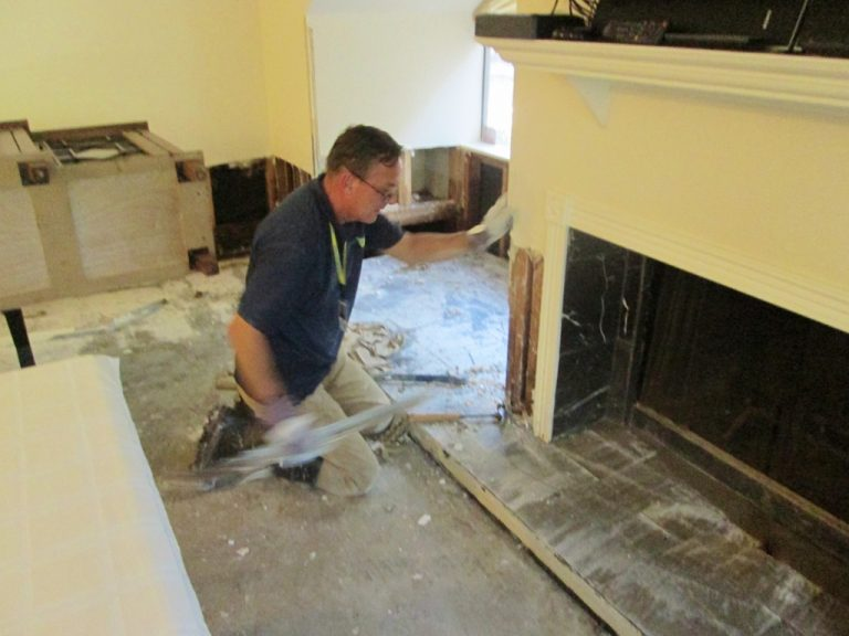 Man working on a fireplace