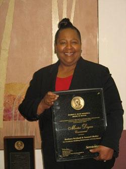 Barbara Neyand holding an award