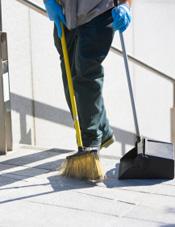 person sweeping floor